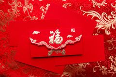 Celebrate Chinese New Year red envelope. With cash banks,ang pao,reward Stock Photo