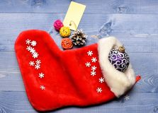 Celebrate christmas. Small items stocking stuffers or fillers little christmas gifts. Contents of christmas stocking. Christmas sock toned wood background top royalty free stock photos