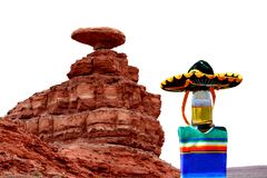 Cinco de Mayo at Mexican Hat, Utah. Celebrate Cinco de Mayo at Mexican Hat, Utah.  The beer bottle is wearing a sombrero and a poncho.  Mexican Hat is a city in stock photos
