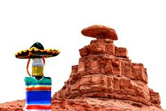 Cinco de Mayo sombrero at Mexican Hat, Utah. Celebrate Cinco de Mayo at Mexican Hat, Utah.  The beer bottle is wearing a sombrero and a poncho.  Mexican Hat is