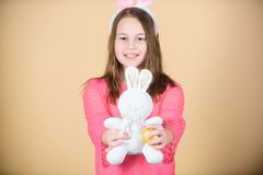 Celebrate easter. Happy childhood. Easter activities for children. Holiday bunny little girl with long bunny ears. Child. Cute bunny costume. Kid hold tender royalty free stock photography