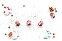 Celebrate Easter. Modern signs of Easter. Chocolate Easter eggs and Easter bunny cookies. White background top view copy. Celebrate Easter. Modern signs of Royalty Free Stock Photography