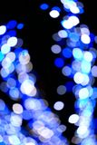 Celebrate the New Year and Christmas, the blue light of the background, shining and greeting everyone. stock photography