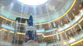 Celebrate the New Year, Fountain and Christmas tree decorate with beautiful light in elegance shopping mall stock footage