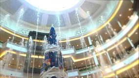 Celebrate the New Year, Fountain and Christmas tree decorate with beautiful light in elegance shopping mall stock video