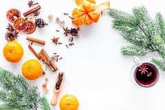 Celebrate new year winter evening with hot drink. Mulled wine or grog ingredients. White background top view. Stock Image