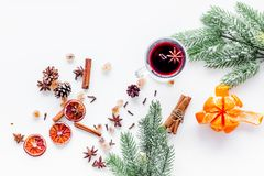 Celebrate new year winter evening with hot drink. Mulled wine or grog ingredients. White background top view. Space for. Celebrate new year winter evening with Stock Image
