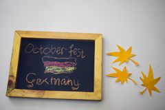 Celebrate october festival - clothes pins on grey/white background and a chalkboard with the slogan `October Fest Germany`.  royalty free stock photography
