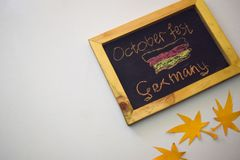 Celebrate october festival - clothes pins on grey/white background and a chalkboard with the slogan `October Fest Germany`.  royalty free stock image