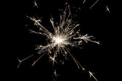 Celebrate party sparkler little fireworks on black background. Use for Christmas and New year and other celebration. Stock Images