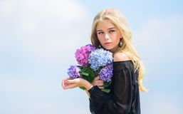 Celebrate spring with bouquet. Girl tender fashion model hold hydrangea flowers bouquet. Meet spring with fresh bouquet royalty free stock photos