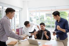 Celebrate success. Business group celebrate a good job in the of royalty free stock images