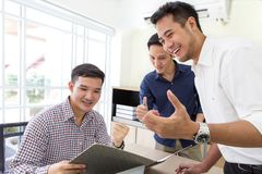 Celebrate success. Business team celebrate a good job in the office. Asian. Stock Photography