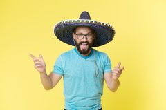 Celebrate traditions. Man on smiling face in sombrero hat celebrating, yellow background. Guy with beard looks festive. In sombrero. Fest and holiday concept royalty free stock photography