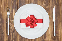 Celebrate valentine's day, gift on a plate Stock Photos