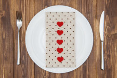 Celebrate valentine's day, Hearts shape and napkin on a plate Royalty Free Stock Photos