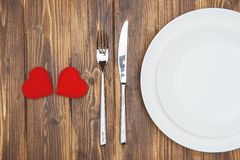 Celebrate valentine's day, Hearts shape and a plate. Romantic Dinner royalty free stock photography