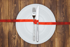 Celebrate valentine's day, Knife and fork on a plate Stock Photography