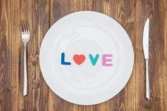 Celebrate valentine's day, word love on a plate Stock Photos