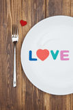 Celebrate valentine's day, word love on a plate Stock Photo