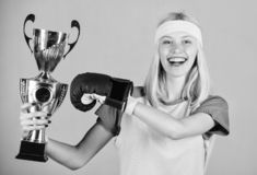 Celebrate victory. Boxing champion. Athletic girl boxing glove and golden goblet. Woman wear sport outfit. Girl cheerful. Boxer winner. Boxing is my hobby royalty free stock image