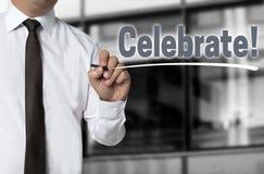 Celebrate wird durch Geschäftsmannhintergrund geschrieben Lizenzfreie Stockbilder
