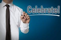 Celebrate wird durch Geschäftsmannhintergrund geschrieben Lizenzfreies Stockbild