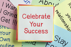 Celebrate Your Success. Top view of Celebrate Your Success handwritten on a note stock image