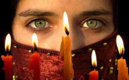 Celebrating. Light candles with a young ladyi's beautiful  green eyes Stock Photos