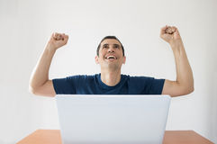Celebrating with arms raised Stock Photo