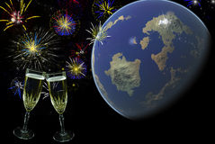 Celebrating Around The World. A champagne toast and fireworks with the world in the background Stock Image