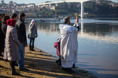 Celebrating Baptism of Jesus and Epiphany bathing in Douro river in the Parish of Russian Orthodox Church Stock Photos