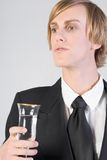 Celebrating - bartender. Full wine glass in hands of young blonde male Royalty Free Stock Images