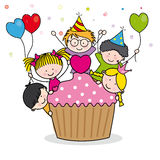 Celebrating birthday party. Children celebrating a birthday. Cupcakes to eat Royalty Free Stock Images