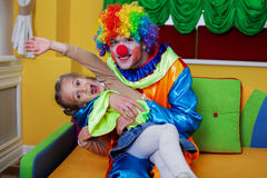 Celebrating birthday party with funny clown. Friendship concept Royalty Free Stock Photos