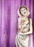 Celebrating blonde attractive lady. Royalty Free Stock Photography