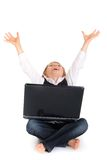 Celebrating boy with laptop Stock Images