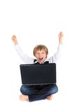 Celebrating boy with laptop Stock Photography