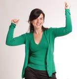Celebrating brunette in green Stock Photography