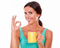 Celebrating brunette woman with coffee mug Stock Photo