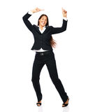 Celebrating businesswoman dancing Stock Photography