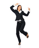 Celebrating businesswoman dancing Royalty Free Stock Images