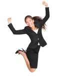 Celebrating businesswoman jumping Royalty Free Stock Image