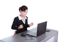 Celebrating businesswoman with laptop computer Stock Images