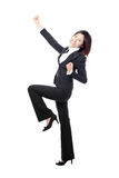 Celebrating cheering businesswoman in full length Stock Photos