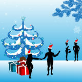 Celebrating Christmas. Colorful background with beautiful decorated Christmas tree, gift boxes and people silhouettes celebrating Christmas Royalty Free Stock Photo