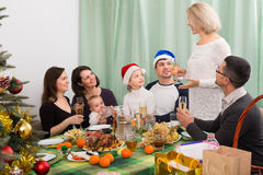 Celebrating Christmas with childrens Stock Image