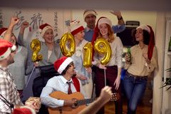 Celebrating Christmas having fun with song business people stock photos