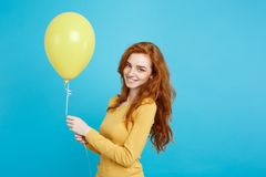 Celebrating Concept - Close up Portrait happy young beautiful attractive redhair girl smiling with colorful party royalty free stock photography