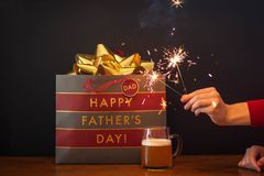 Celebrating Dad with sparklers and beer royalty free stock photo